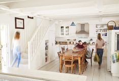 Interior Of Busy Family Home With Blurred Figures stock photo