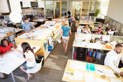 Interior Of Busy Modern Open Plan Office. With People Stock Photo