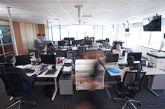 Interior Of Busy Modern Open Plan Office With Staff Stock Photo