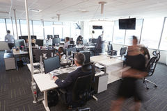 Interior Of Busy Modern Open Plan Office With Staff royalty free stock photography