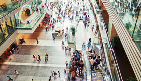 Busy shopping mall. Interior of busy retail shopping mall. Many people in modern commercial business shopping mall royalty free stock photo