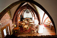 Interior of cafe in the old catholic church with brick walls Stock Image
