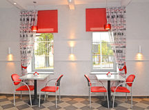 Interior of cafe with red chairs Stock Photos