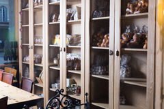 Interior of cafe with sweet stuff in cupboards. Delicious sweet stuff assortment in coffee section of bakery Royalty Free Stock Image