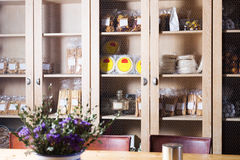 Interior of cafe with sweet stuff in cupboards. Delicious sweet stuff assortment in coffee section of bakery Stock Photos