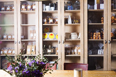 Interior of cafe with sweet stuff in cupboards. Delicious sweet stuff assortment in coffee section of bakery Royalty Free Stock Images