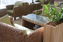 Tables and rattan chairs stock image