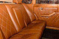 Interior of the car is a brown color and leather. 2019 royalty free stock photography
