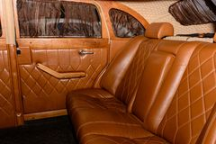 Interior of the car is a brown color and leather. 2019 stock photography