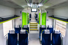 Interior of the car of diesel train PESA 730M DP3 of the Belar. Interior of the polish diesel train PESA 730M DP3 of the Belarussian railway Royalty Free Stock Photography