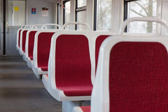 Interior of the car with empty seats on commuter trains Royalty Free Stock Photos