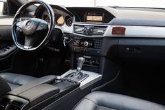 The interior of the car Mercedes Benz E-class E250 with a view of the steering wheel, dashboard, seats and multimedia system with royalty free stock photography