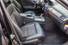 The interior of the car Mercedes Benz E-class E250 with a view of the steering wheel, dashboard, seats and multimedia system with stock photos