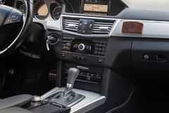 The interior of the car Mercedes Benz E-class E250 with a view of the steering wheel, dashboard, seats and multimedia system with royalty free stock photos