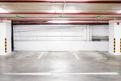 Interior car park zone with white line for car and green sensor. Interior car park zone with white line for car and green sensor wireless control on ceiling for Royalty Free Stock Photo