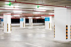 Interior car park zone with white line for car and green sensor. Interior car park zone with white line for car and green sensor wireless control on ceiling for Stock Photo