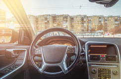 Interior of the car, steering wheel and dashboard. Interior of the car, the driver`s seat Stock Image
