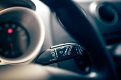 Interior car wiper controls on modern car. Cockpit interior of car with electronic controls of rain wipers Stock Images