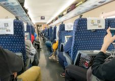 Interior of carriage on High speed train in China. XI`AN, CHINA - 18 OCTOBER 2018: Interior of carriage on Chinese high speed train or CRH in Shaanxi province royalty free stock photography