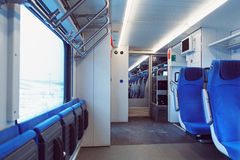 The interior of carriage with seats for passengers and their bicycles in high-speed commuter train. The interior of carriage with seats for passengers and their Royalty Free Stock Photography