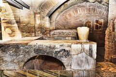 Interior of the Caseggiato del Termopolio :  marble countertop - Ostia Antica. Interior of the Caseggiato del Termopolio : marble countertop - Ostia Antica Royalty Free Stock Photos