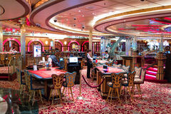 Interior of Casino `Royale` on large cruise ship `Voyager of the Seas`. Royal Caribbean International cruise company. Stock Photos