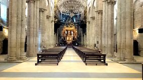 Interior of the Cathedral of Santiago de Compostela. With a large lamp in the center stock photos