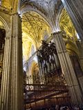 Interior of the Cathedral in Seville in Andalucia Spain. Cathedral of Seville. It is amongst the largest of all medieval and Gothic cathedrals, The interior is Stock Image