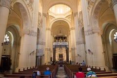 Interior of the catholic church of Ta Pinu, Malta. GHARB, GOZO, MALTA - AUGUST 22, 2017: People praying in theTa Pinu Roman Catholic minor basilica church and Royalty Free Stock Photography