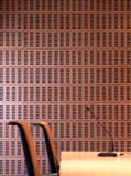 Interior ceramic wall detail with chairs and microphone. Royalty Free Stock Photo