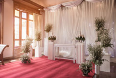 Interior ceremony wedding room decoration by red carpet and fabric white background Royalty Free Stock Photos