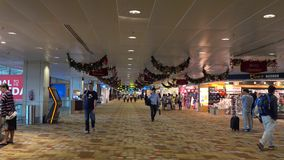 Interior of Changi Airport. People walk at Changi Airport in Singapore. It is currently the World's Best Airport (Skytrax 2015), and is one of the world's stock video