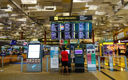 Interior of Changi Airport in Singapore. Singapore - Jun 14, 2017. People looking at information in Changi Airport, Singapore. Changi serves more than 100 Stock Photography