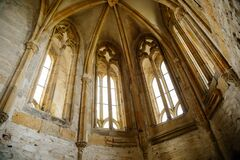 Interior of Chapel of St. Archangel Michael in medieval castle Bezdez, gothic arched windows in church, rib vault, altar part,