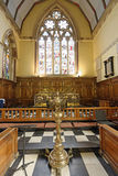 Interior of Christ Church, Oxford. Classic church interior with lecturn and stained glass windows in oxford, england stock photo