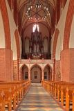 Interior of church. Or cathedral looking down aisle Stock Image