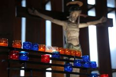 Interior of the Church with candles and the crucifix Royalty Free Stock Images