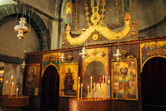 The interior of the church. Icons, chandelier, candles in a small church Stock Image