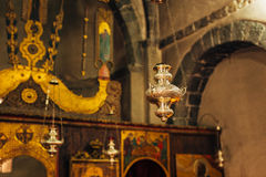 The interior of the church. Icons, chandelier, candles in a small church Royalty Free Stock Image