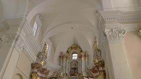 Interior of a church. Religious paintings on the wall. Cathedral in Vilnius. Beauty of christian culture stock video footage