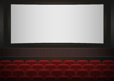 Interior of a cinema movie theatre. Red cinema or theater seats in front of white blank screen. Empty Cinema auditorium Royalty Free Stock Photo