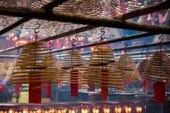 Interior circular incense of Man Mo Temple Hong Kong. Interior circular incense and red Chinese lanterns of Man Mo Temple Hong Kong, China, Asia Royalty Free Stock Image