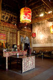 Interior of clan temple in penang. Interior of a chinese clan temple with traditional wall chinese painting and wood carving Royalty Free Stock Photos