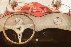 Interior of a classic kit car convertible. Retro styled image of the interior of a classic red kit car convertible Stock Image