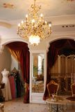 Interior in classic style. The interior in classic style with gold chandelier Stock Photos