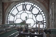 Interior clock tower mechanism stock images