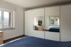 Interior, closet with mirror of a bedroom. Apartment interior, big closet with mirror of a bedroom stock images