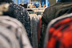 Interior of clothes store with different women clothes on hangers. royalty free stock photo