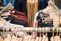 Interior of clothes store with different women clothes on hangers. stock photography