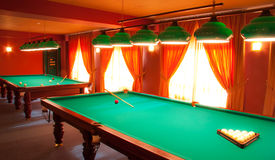 Interior of a club having billiard tables. Illuminated with lights Stock Image